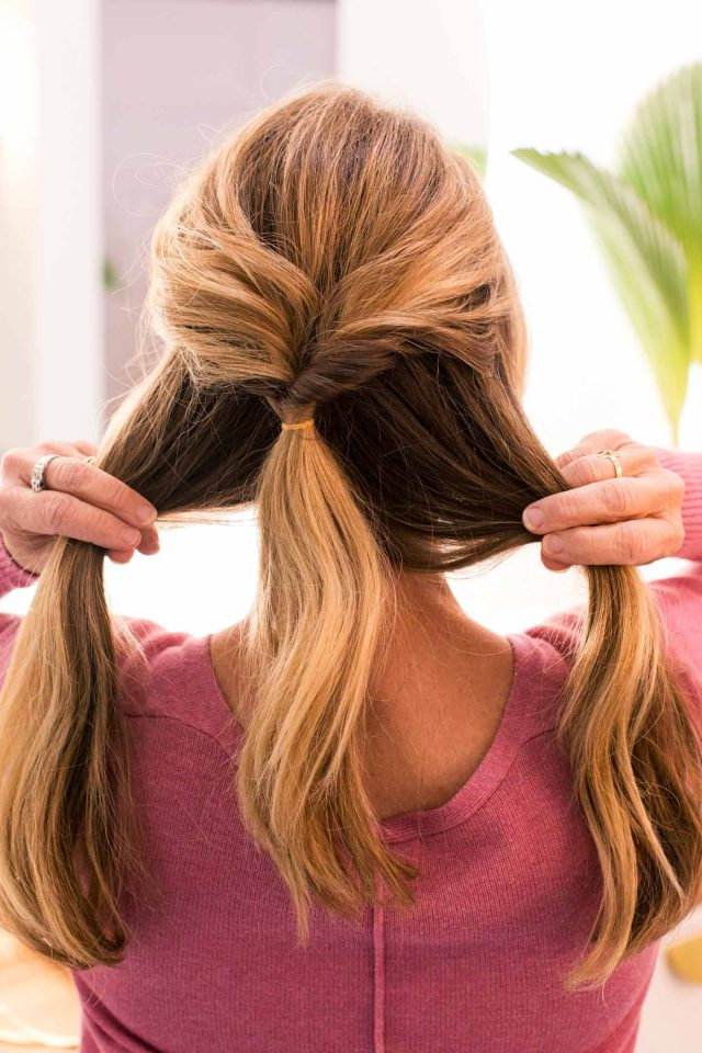 photo of how to style a double low ponytail by top Houston lifestyle blogger Ashley Rose of Sugar & Cloth