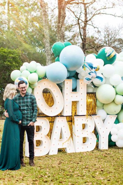 """oh baby"" giant marquee letters and a man and woman"