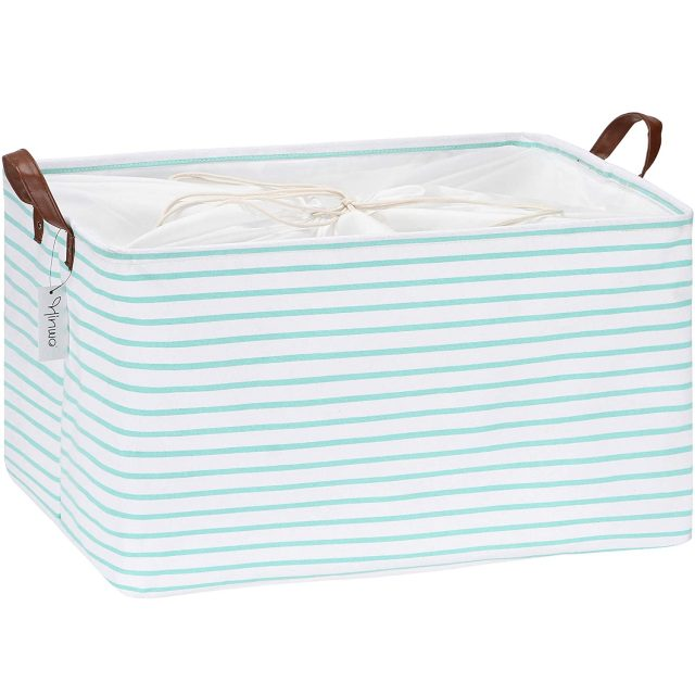 photo of the Mint Striped Collapsible Storage Bin as an Easter basket of kids by top Houston lifestyle blogger Ashley Rose of Sugar & Cloth
