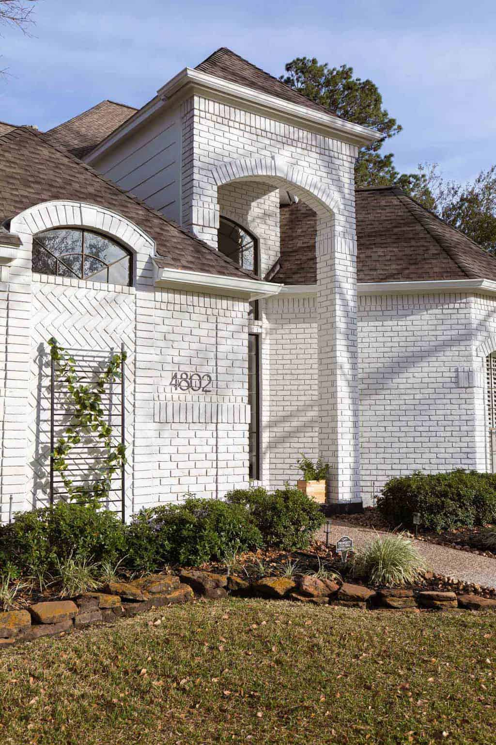 angled photo of an exterior limewash paint job on brick