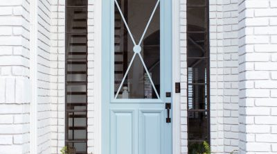 photo of an updated front porch and blue door
