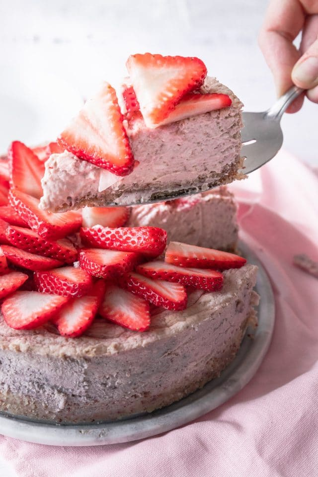 photo of the Keto Strawberry Cheesecake being served by top Houston lifestyle blogger Ashley Rose of Sugar & Cloth