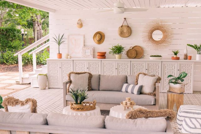 horizontal photo of outdoor sofas and cabinets in styled setting