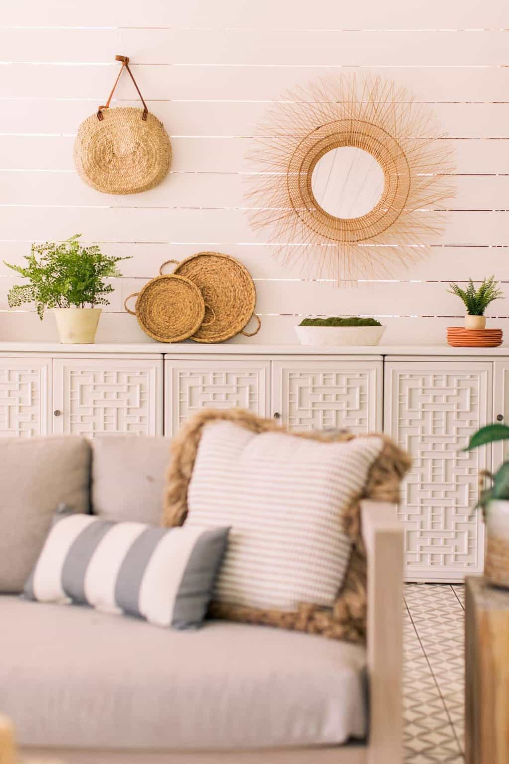 outdoor sofa cushions in front of shiplap outdoor walls