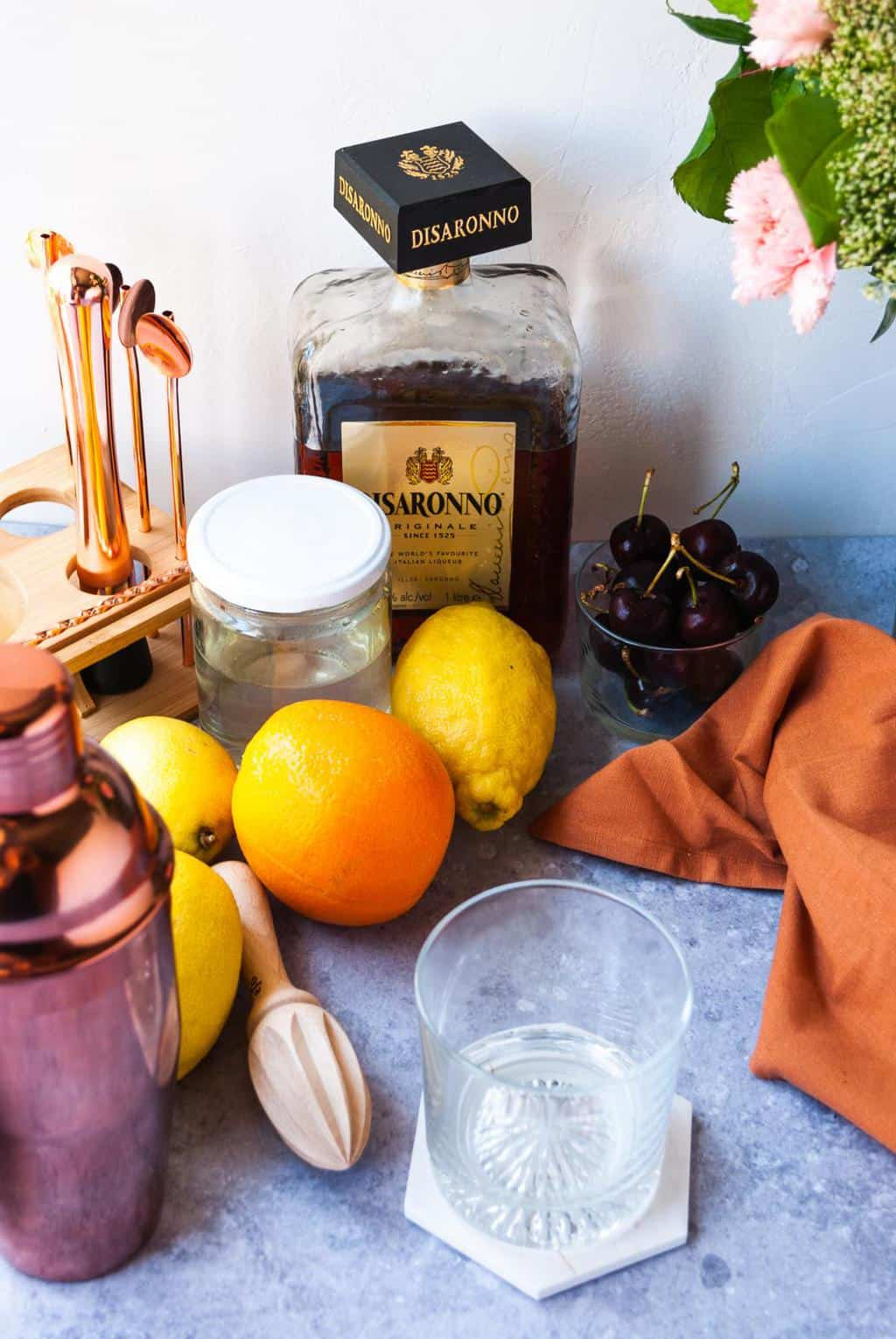 What's in an Amaretto Sour - A photo of all the tools and ingredients to make the drink.