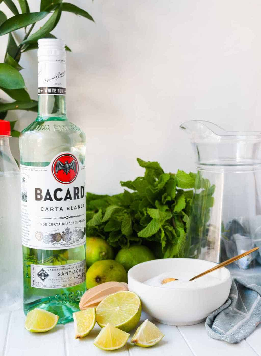 how to make a pitcher of mojitos - a photo of ingredients used to make the mojito drink.