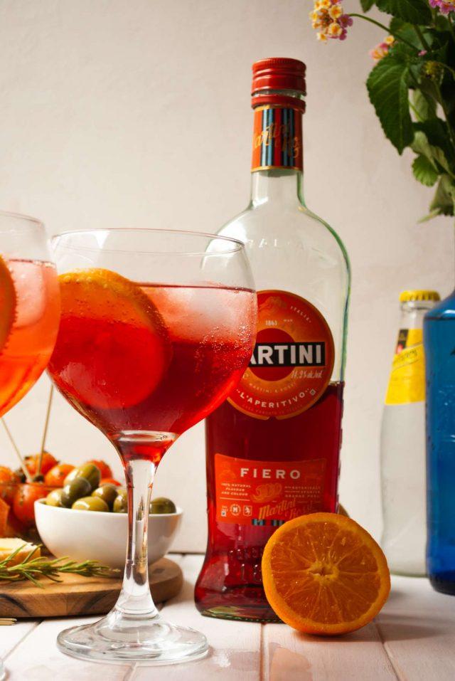 martini rossi - a glass and bottle of martini fiero