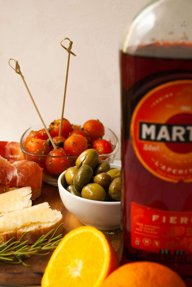 martini and rossi fiero - a platter of fruits with a side bottle of martini fiero