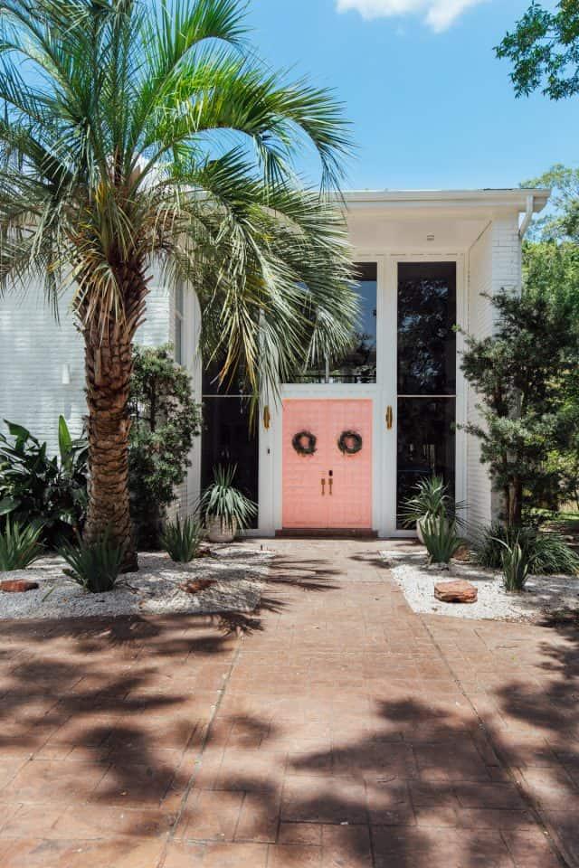 pink front door and driveway