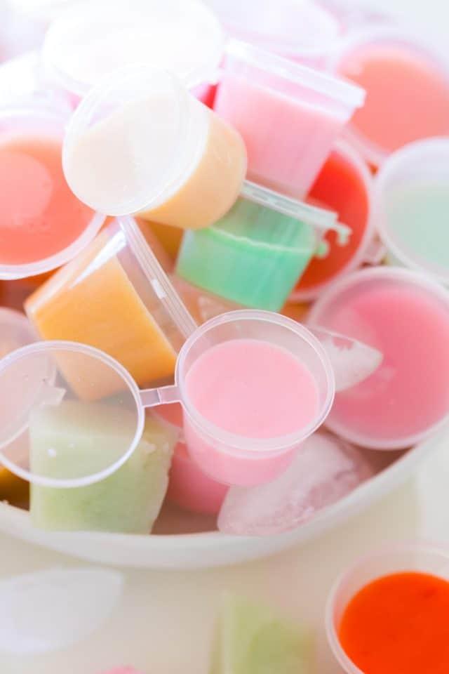 vodka jello shots - a close up of different jello shots in a bowl.