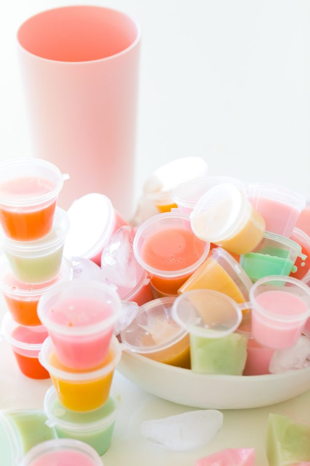 how to make jello shots - stacks of different colored jello shots in a bowl