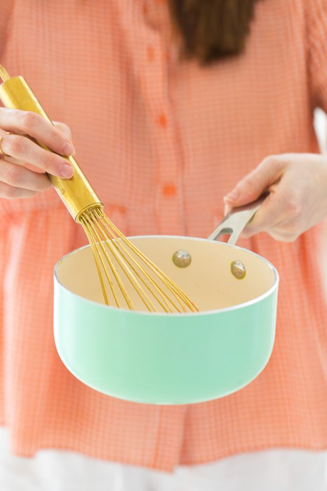 how to make jello shots with vodka - a photo of mixing the ingredients in a pan using a whisk.