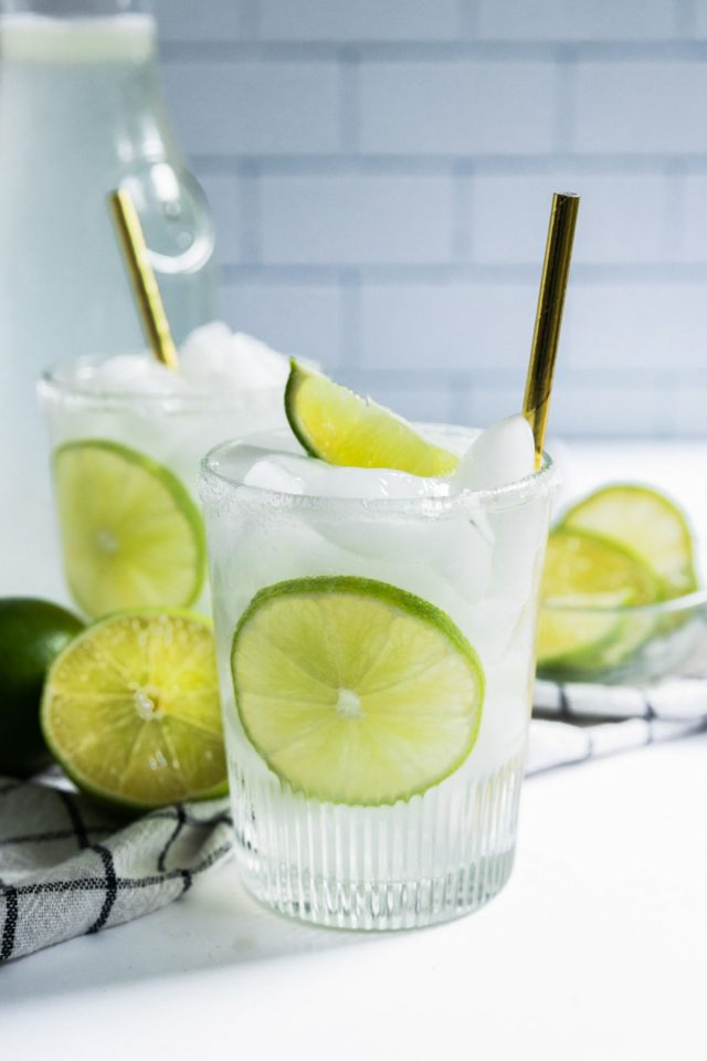 simple limeade - limeade drink with sugar on the rim of the cup as garnish
