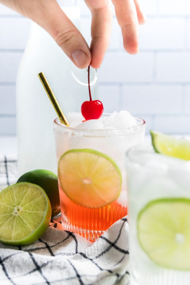 how to make limeade - putting a top cherry on a limeade cherry drink