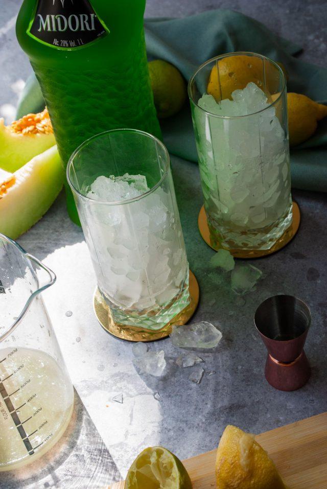 Midori Sour Recipe - two tall glass full of ice