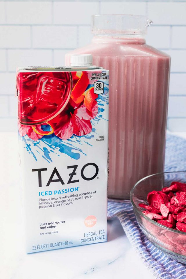 how to make starbucks pink drink - a photo of tazo product along with the mixed pink drink inside the pitcher.