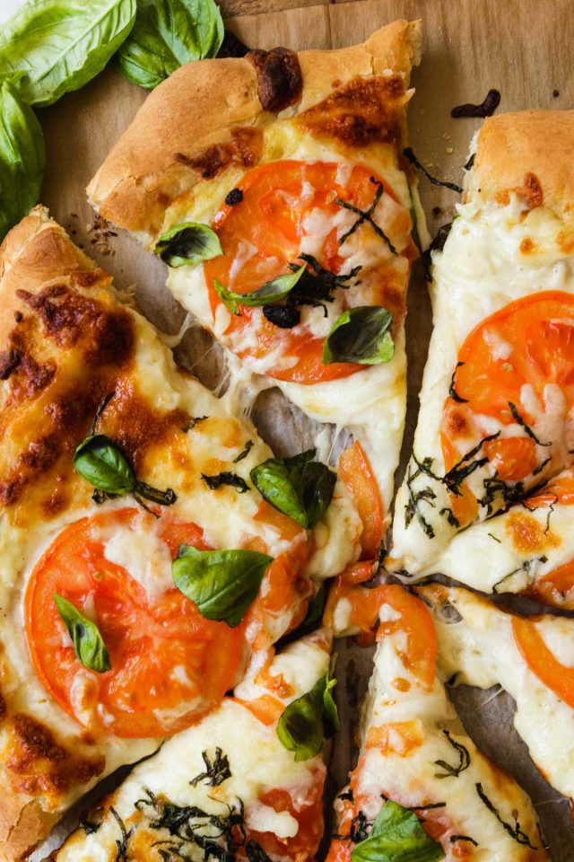 white pizza recipe - sliced white pizza with toppings